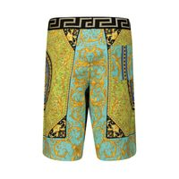 Picture of Versace YD000184 kids shorts yellow