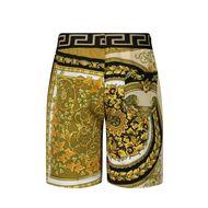Afbeelding van Versace 1000340 baby shorts wit/goud