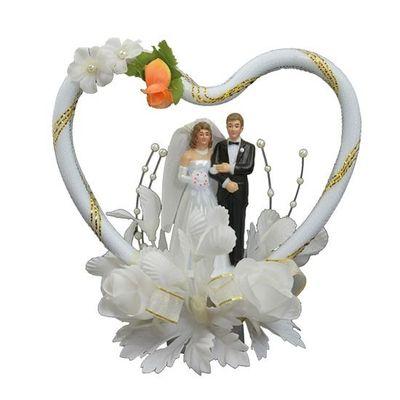 Foto van Taartdecoratie bruidspaar in hart