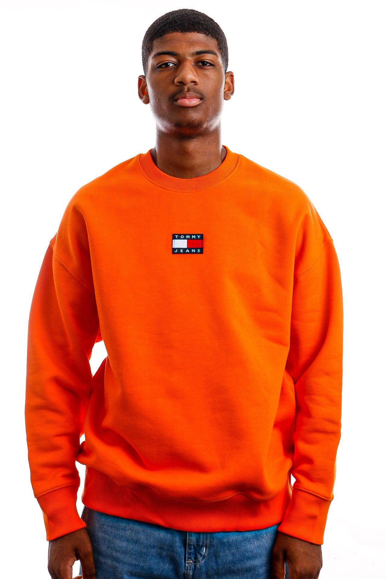 Afbeelding van Tommy Jeans Crewneck TJM TOMMY BADGE Sef Magnetic Orange DM0DM10911