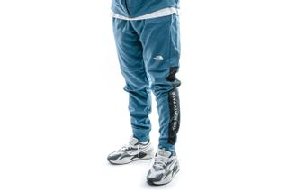 Foto van The North Face Broek M Tnl Cuffed Pant Mallard Blue NF0A4MA1Q311