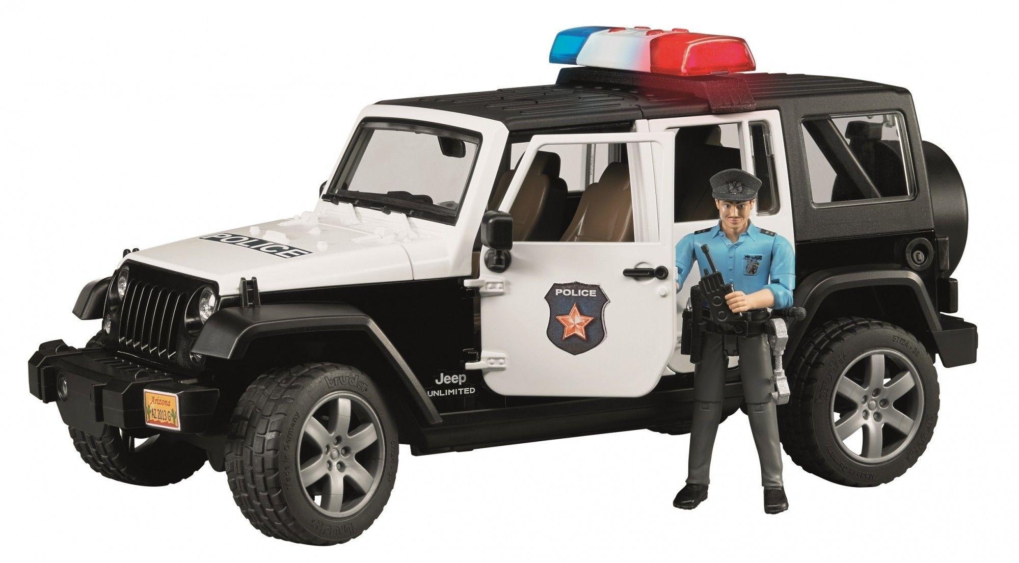 Bruder Jeep Wrangler politieauto en politieman 1:16