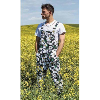 Foto van Run & Fly | Zwarte tuinbroek met grote madelief print, unisex