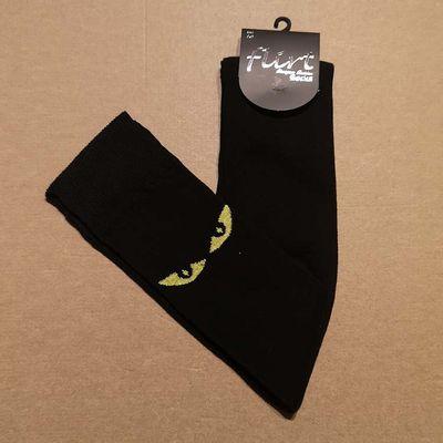 Foto van Flirt | Overknee sokken zwart met gele kattenogen